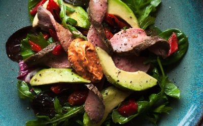 Mixed green salad with steak and paprika aioli